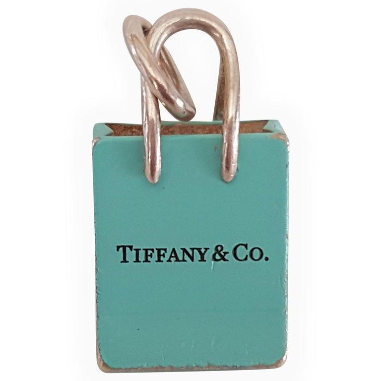 Pre-Owned Tiffany & Co. Silver Signature Blue Purse Pendant, Enamel Finish For Sale