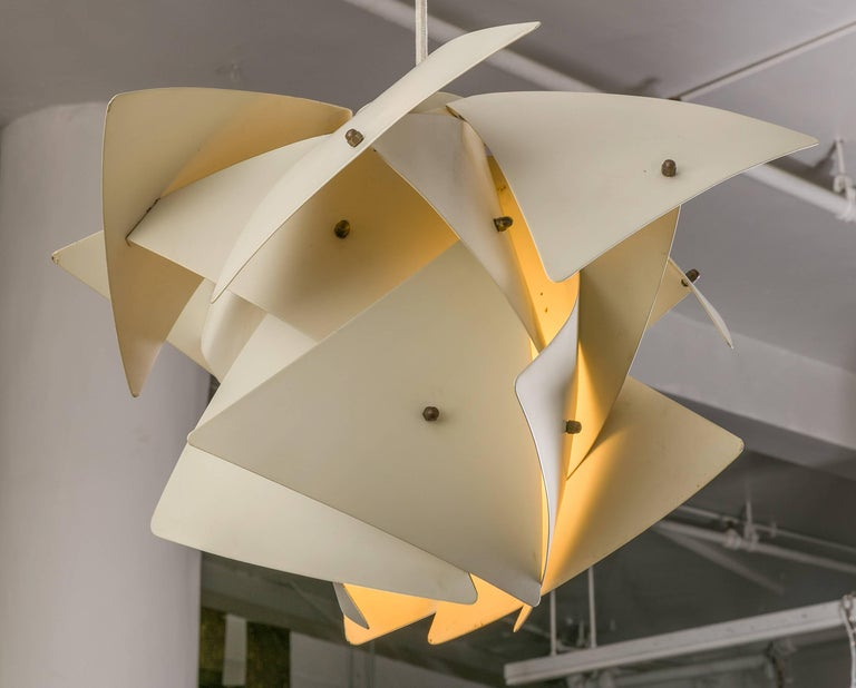 Preben Dahl's Symfoni lights are immediately recognizable for their distinctive design. This rare pendant has similar geometric lines but takes it a step further with subtle petal like panels.