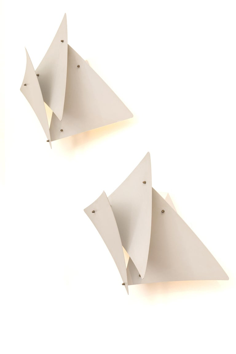 Preben Dahl's Symfoni lights are immediately recognizable for their distinctive design. These sconces are rare due to the untypical subtle petal like panels not usually seen on his other lights.