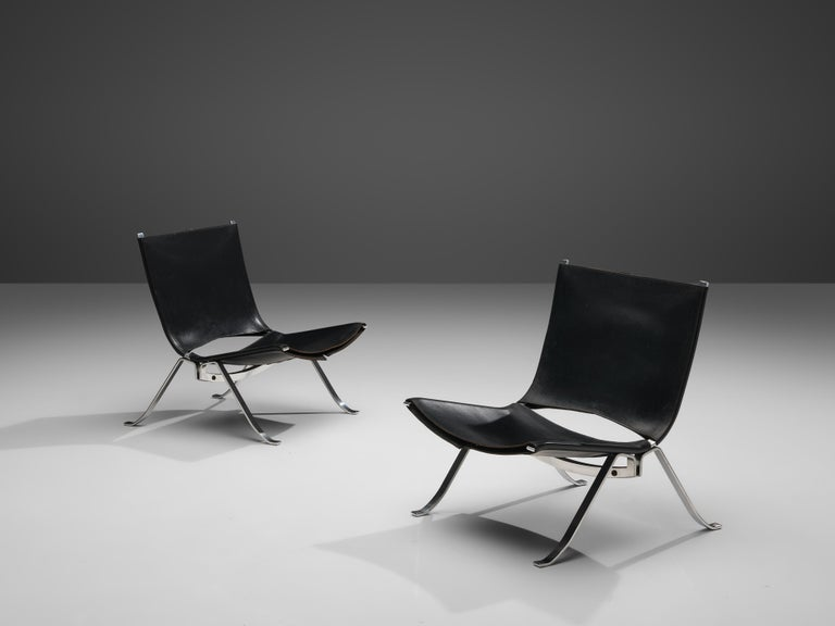 Preben Fabricius for Arnold Exclusiv, pair of easy chairs, chromed steel, black leather, Denmark, 1971  A pair of lounge chairs by Preben Fabricius. The very well-formed metal frames hold a sturdy black leather upholstery, tied together with a rope.