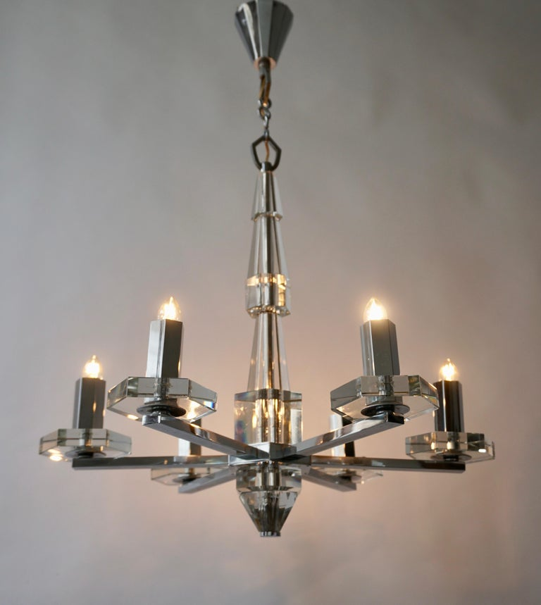 Precious faceted crystal glass Art Deco chandelier. The beautiful chandelier takes six E14 standard screw bulbs to illuminate. The wiring is very good so it is in fine working order and ready to use. The total length is about 70 cm, and it has a