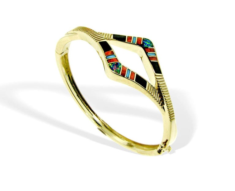 14 karat gold precious Australian opal, Sleeping Beauty Turquoise, Spiny Oyster and Black Onyx inlay bracelet designed by International award-winning jewelry designer, Jonathan Duran, with the