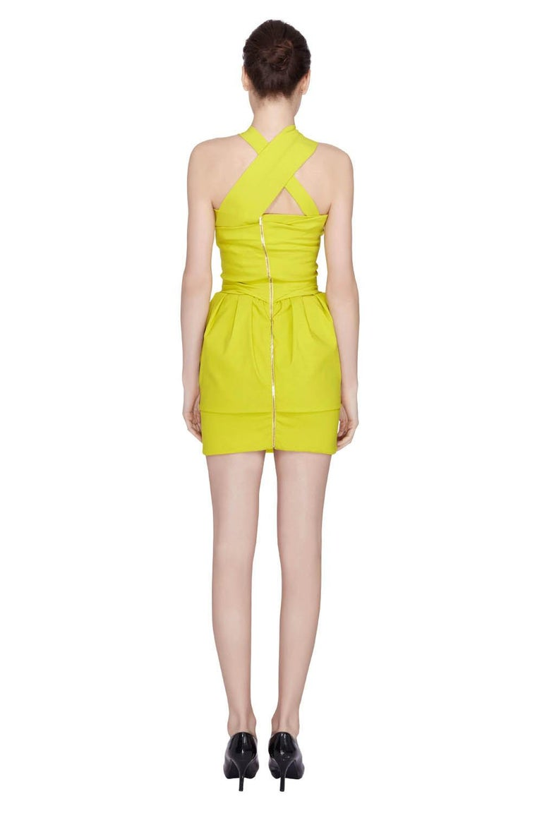 Welcome summer with this fun Preen by Thorton Bregazzi cocktail dress. It is perfect to wear at a beach party or for an evening outing. It features a gorgeous citrus green color, draped bodice and stylish crisscross neckline. Complete your look with