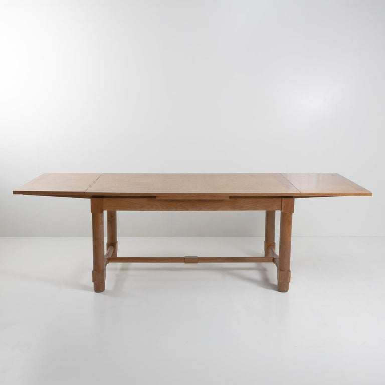 Very pretty presentation table with extensions in solid oak, the top in oak marquetry.    The tabletop is supported by four sturdy but elegant legs, the legs are circular but square at the junctions with the side spacers. The rectangle pattern is