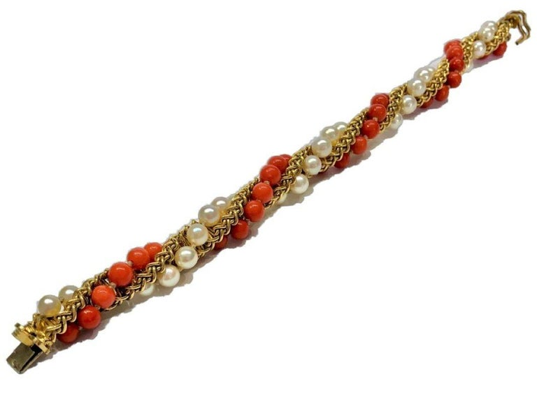 French Cut Prestigious French Cartier Twisted Gold, Coral and Pearl Torsade Bead Bracelet For Sale