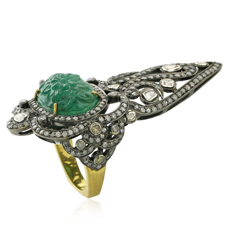 Oval shape carved emerald knuckle ring with pave and rosecut diamonds is pretty chic yet classic looking.  Ring Size: 7 ( can be sized )  18k: 3.12g Diamond: 3.35ct Slv: 8.31gm Emerald: 9.10ct
