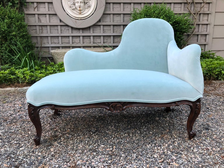 Very pretty vintage settee newly upholstered in a Tiffany blue cotton velvet. Curved back and diminutive size make this perfect for a bedroom or hallway. Measure: Seat height is 16.