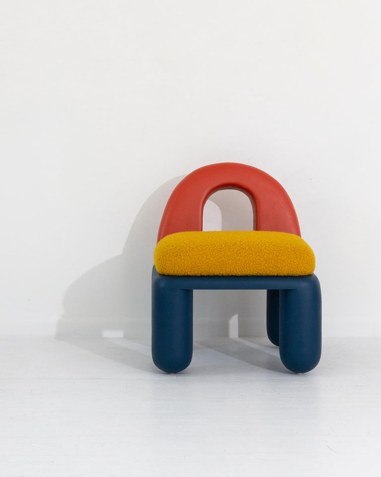 The Primary Chubby chair is a variation of the original Chubby chair, combining the architectural elements of hand carved arches and turned columnar legs with the bold colors that comprise the basis for all the hues we see. A low lounge chair that