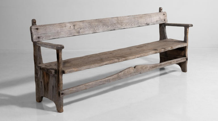 Weathered bench constructed in teak.