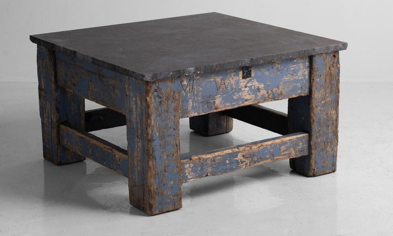 Beautiful stone top on robust wooden base with remnants of original paint.