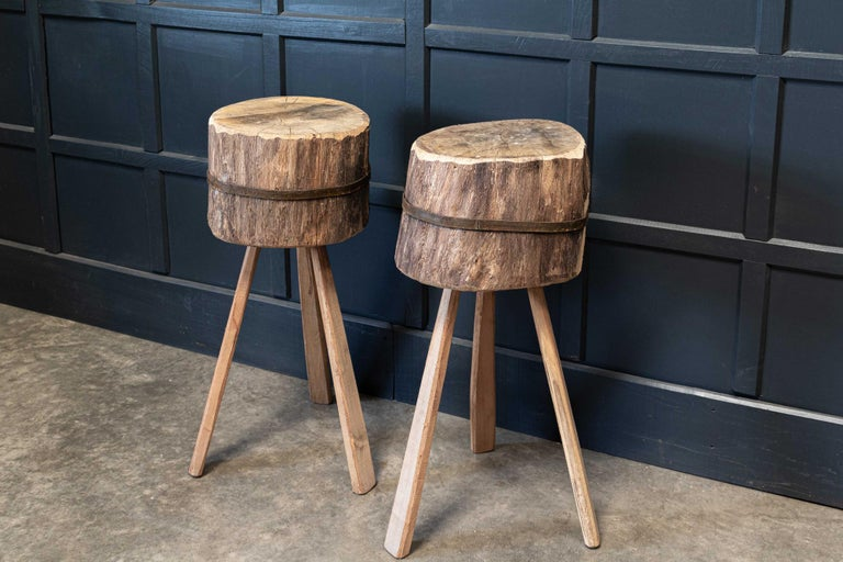 Circa. 1900  Primitive chopping block end tables, elm pegged legs and banding.  Price is each    Set 1 L - Diam 32.5 x H78cm Set 1 R - Diam x D36 x H80cm  Set 2 L - Diam 35 x H83cm Set 2 R - Diam 35 x H83cm  Set 3 L - Diam 35 x