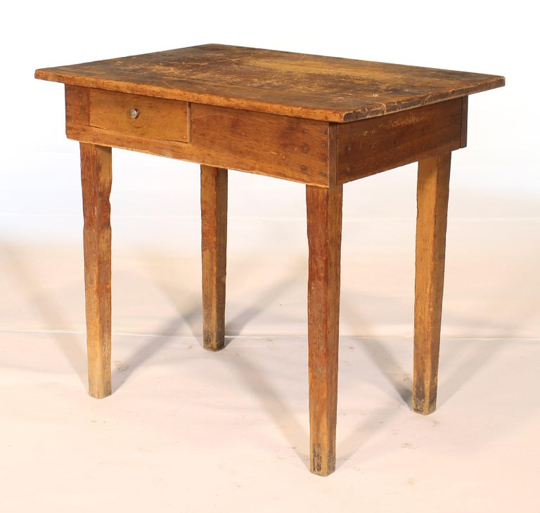 Antique Primitive country / farm style wooden desk / school table with a single drawer. Incredible natural wear to the desk all around, especially the top and legs. Measures: 31 1/4