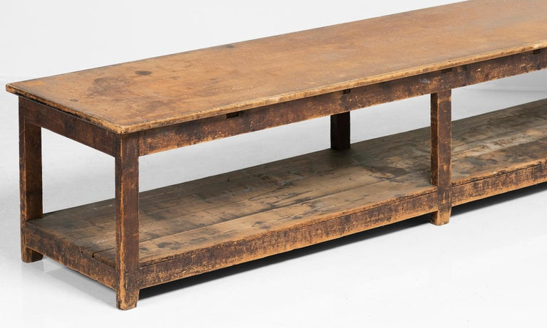 Massive work table constructed in pine with composite wood top.