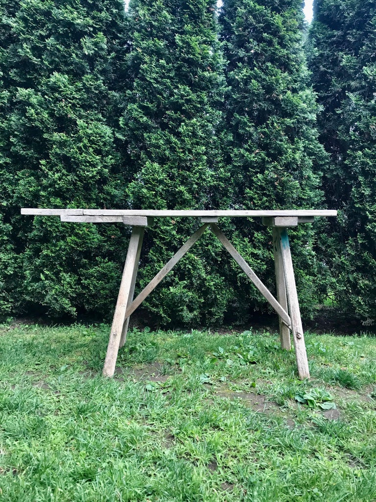 Originally used by French housewives to scrub laundry down by their local river or lake, tables such as these are now very difficult to find in France, as they are immediately snapped up for their elegant, simple form, worn tabletop surfaces, and