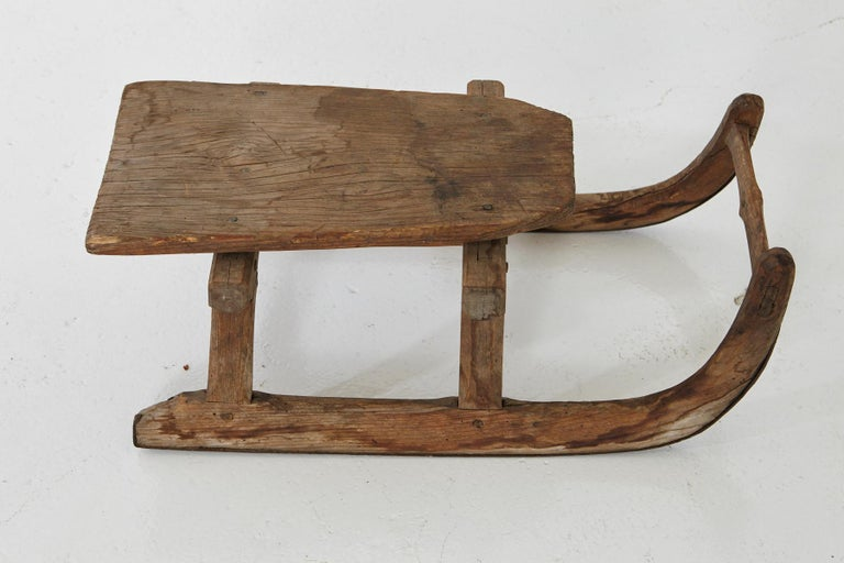 Lovely hand carved primitive, puristic wooden sleigh for one person, probably end of the19th century.