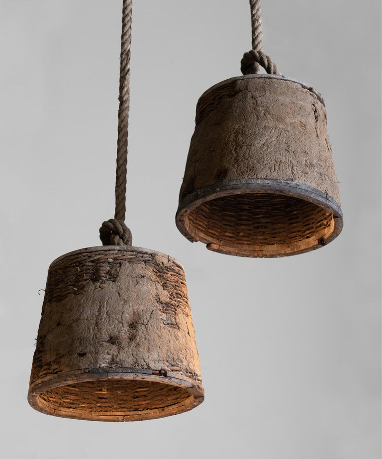 """Weathered wood and basket shade, with thick rope.     Measures: 16.85"""" diameter x 13.25"""" height (96"""" Rope)."""