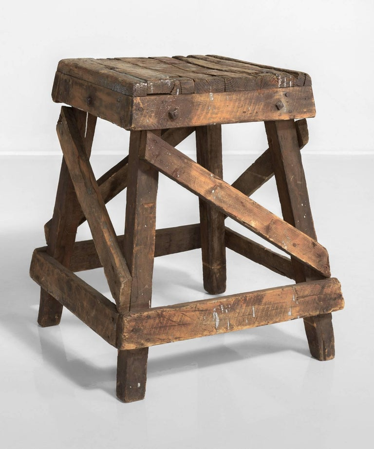 Primitive sculptor stand, England, circa 1900.  Primitive stand with generous height, slate top and stretcher supports.