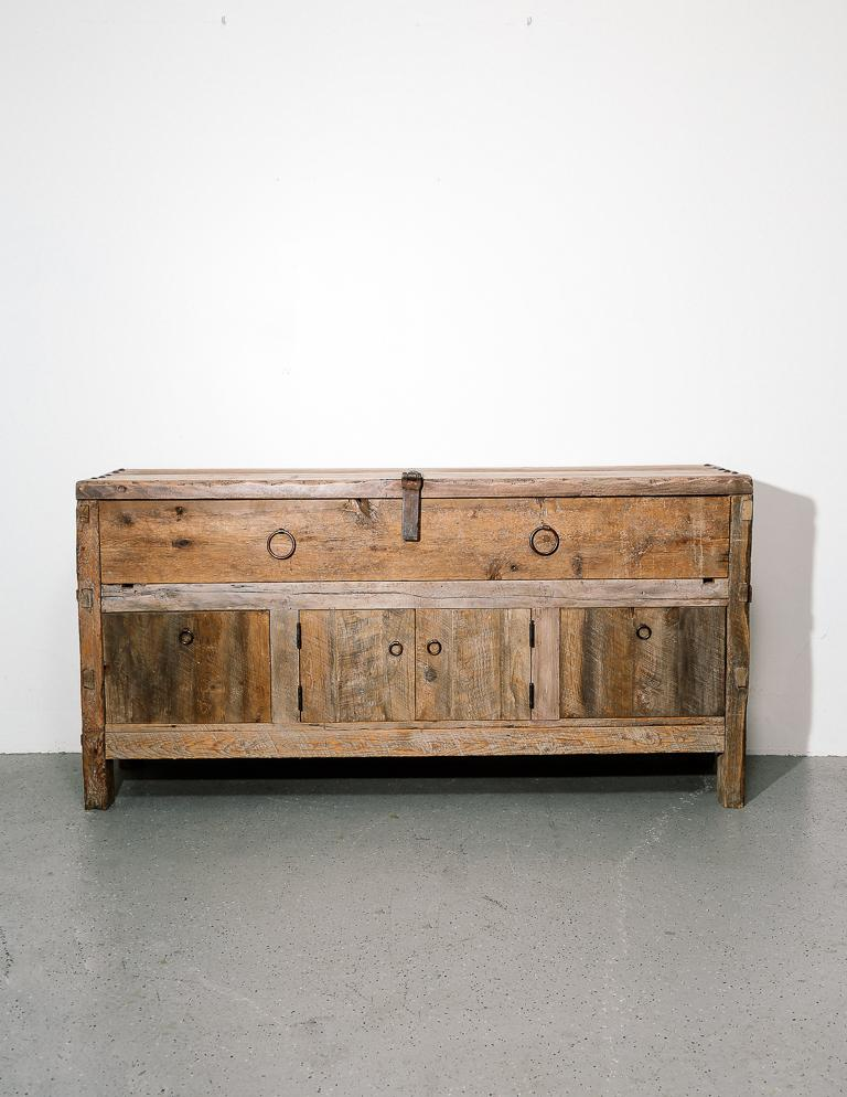 Primitive style credenza or sideboard built from reclaimed materials. Iron ring pulls and latch. One large drawer, 2 smaller drawers, and 2-door cabinet. There is a hole cut in the back for electronics.