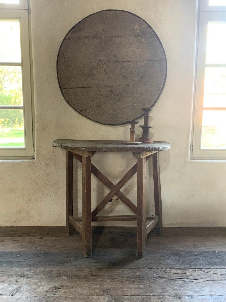 A 19th century winetable top mounted as a circular painting. These tables were used by French and Italian farmers to have a meal on the field or a glass in the winecellar. With their folding top they were light and easy to carry around. This example