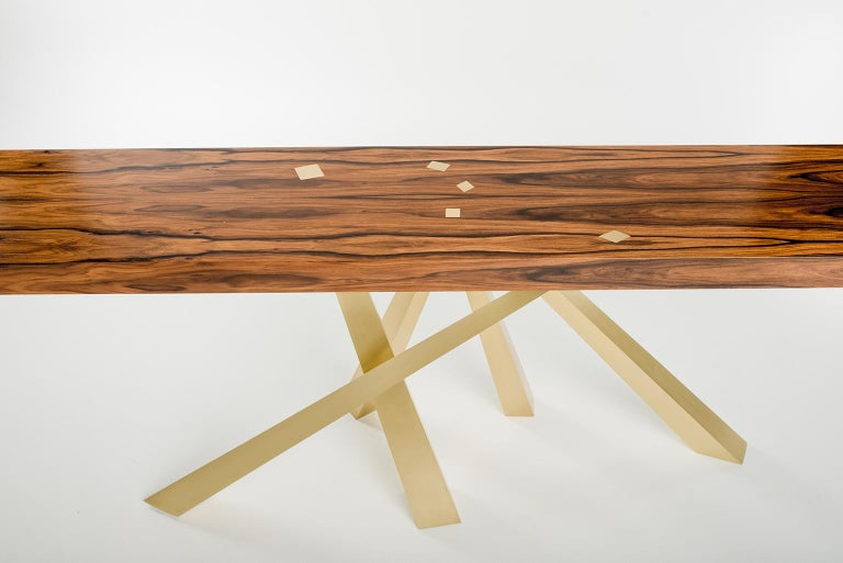 This beautiful table plays with the idea of balance and harmony while at the same time embracing a sense tension. The legs are precisely engineered to be perfectly stabile even though it feels almost as if they just happened to fall that