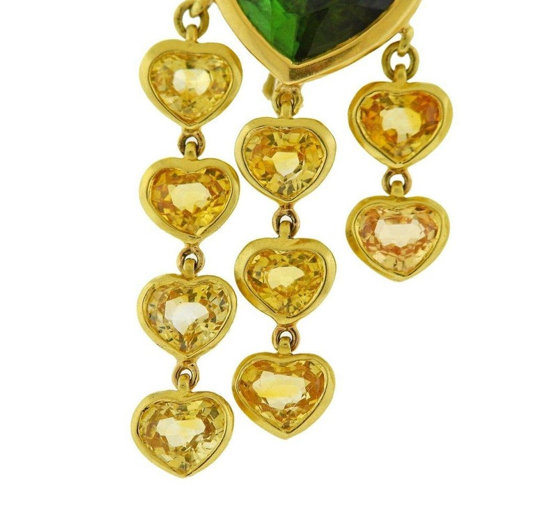 18k gold earrings crafted by Prince Dimitri. Earrings feature approx 8.36ctw in tourmaline and 11.08ctw in yellow sapphires. Retail is $6000. Earrings are 40mm x 22mm. Total weight 18.8 grams. Marked Prince Dimitri mark, 750.