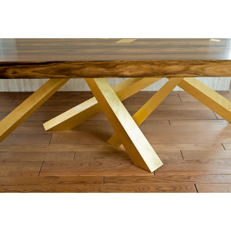 This beautiful table plays with the idea of balance and harmony while at the same time embracing a sense tension. The legs are precisely engineered to be perfectly stable even though it feels almost as if they just happened to fall that way.