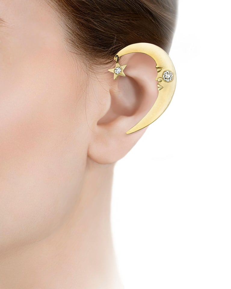 This imaginative ear cuff was once owned by the pop icon Prince and worn on stage during his performances throughout the 1990s. Taking the form of a crescent moon wearing a stoic expression, the 14K yellow gold cuff features 0.50 carat of white