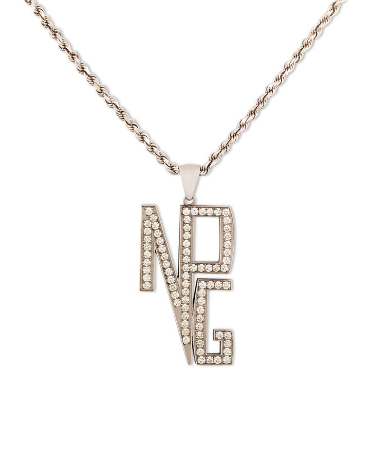 The bold and opulent style of musical icon Prince is on full display in this one-of-a-kind white gold necklace. The letters