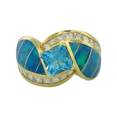 Princess Blue Topaz and Opal Inlay Mele Ring with .10 Carat Diamond Accents, 18K