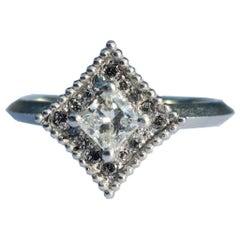 Princess Cut Diamond and 14 Karat White Gold Ring