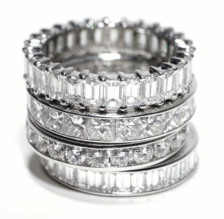Princess cut diamond platinum channel set eternity wedding or anniversary ring  Princess cut diamond weighing 2.75 carat  Width 3.5mm New ring  Diamond quality G VS  Ring size 6 In Stock The ring cannot be sized Handmade in the USA Wear and time