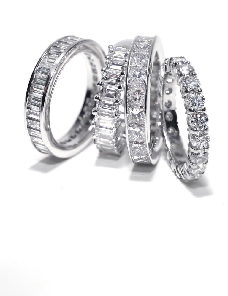 Contemporary Princess Cut Diamond Eternity Platinum Wedding Band Weighing 2.75 Carat For Sale