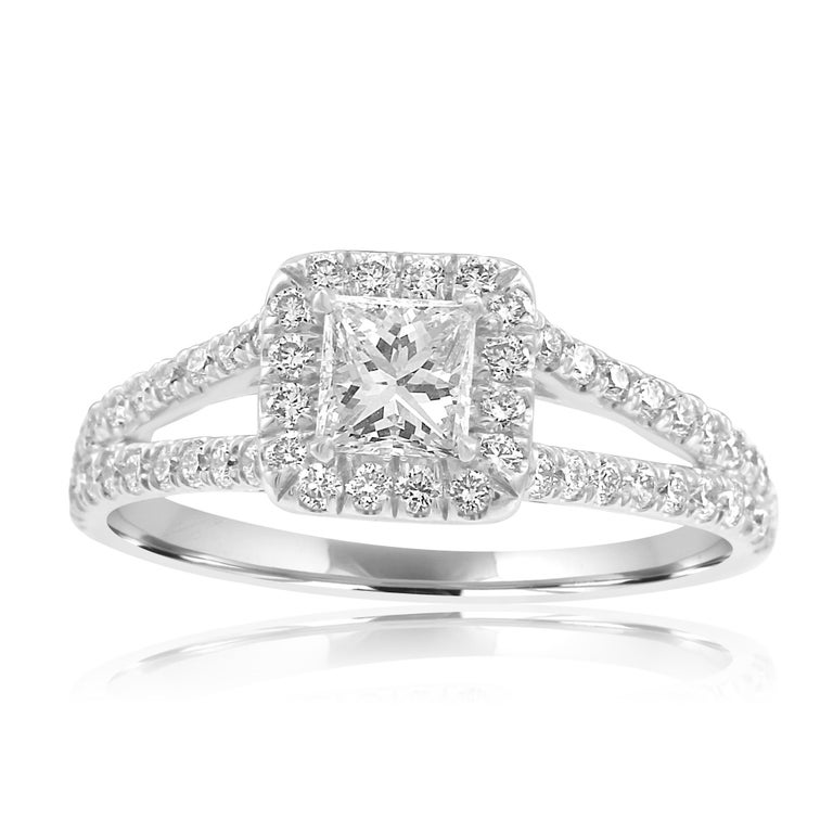Gorgeous White Princess Cut Diamond G-H Color SI Clarity 0.42 Carat encircled in a Single Halo of White G-H Color VS-SI Clarity 0.50 Carat Round Diamonds in classy split shank 18K White Gold Bridal Fashion Ring.  Total Diamond Weight 0.92 Carat MADE
