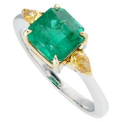 Princess Cut Emerald and Pear Shape Yellow Diamond Ring in 18 Karat Gold