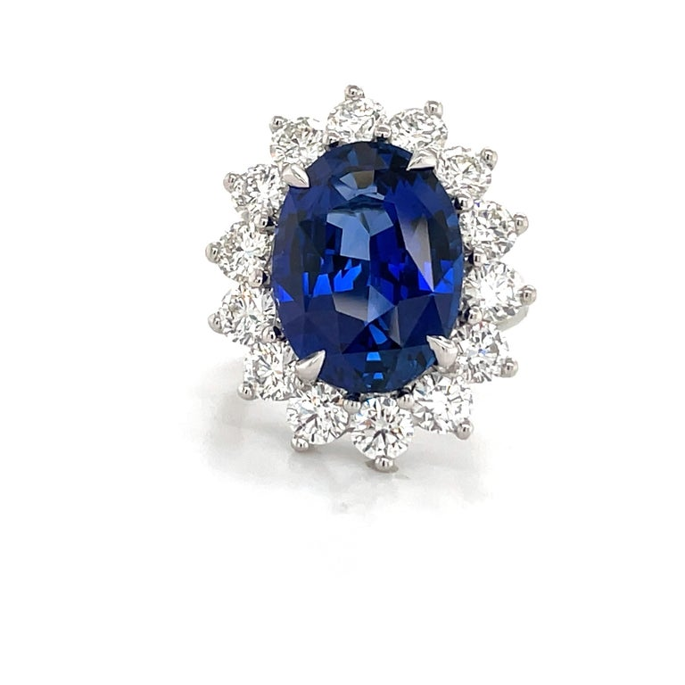 Princess Diane inspired cocktail ring featuring one GIA Certified Oval Sapphire weighing 12.06 carats flanked with 14 round brilliants weighing 3.25, crafted in Platinum.  Sapphire: Origin: Madagascar Measurements: 16.35 x 12.08 x 7.33 mm Sapphire