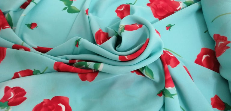 PRICE IS PER YARD Artwork: Original watercolor long-stem rose print is handprinted and designed in France. Content: 100% long filament, best quality mulberry silk yarn weaved into luxurious Double Crepe Georgette. Country of production: Screen