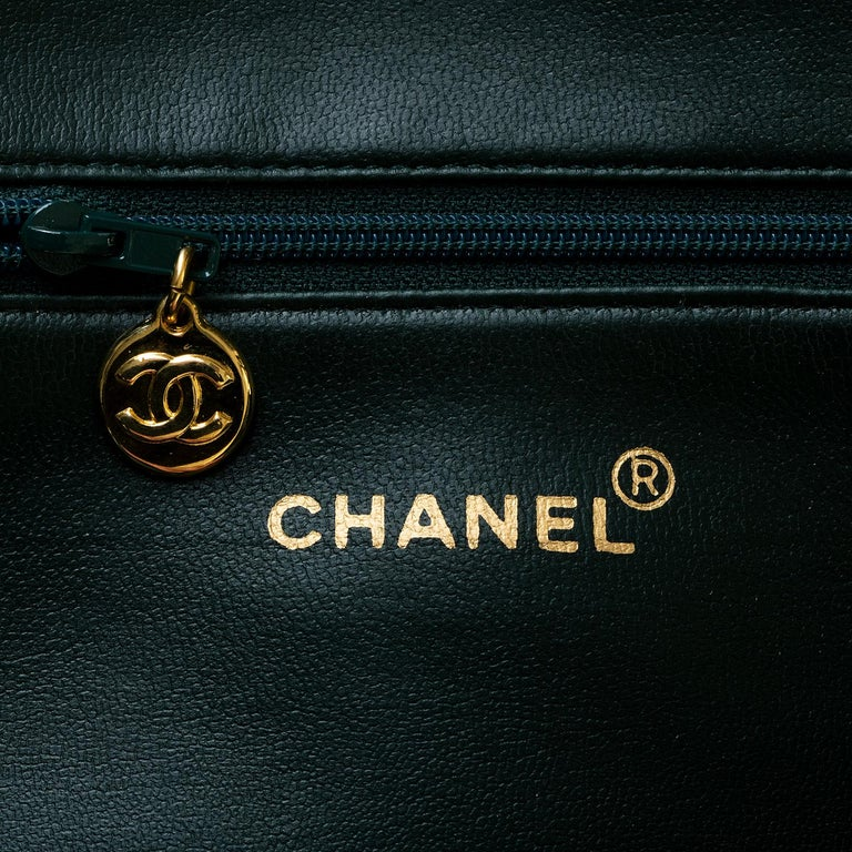 This rare colour Chanel shoulder bag is finished in Emerald Green Caviar calf-skin leather, complemented with gold hardware, accented with iconic signature Chanel globes. The ideal everyday, go anywhere bag, it is in pristine condition throughout,