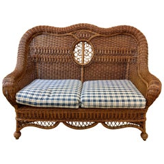 Pristine Wicker Loveseat with Blue and White Upholstered Cushions