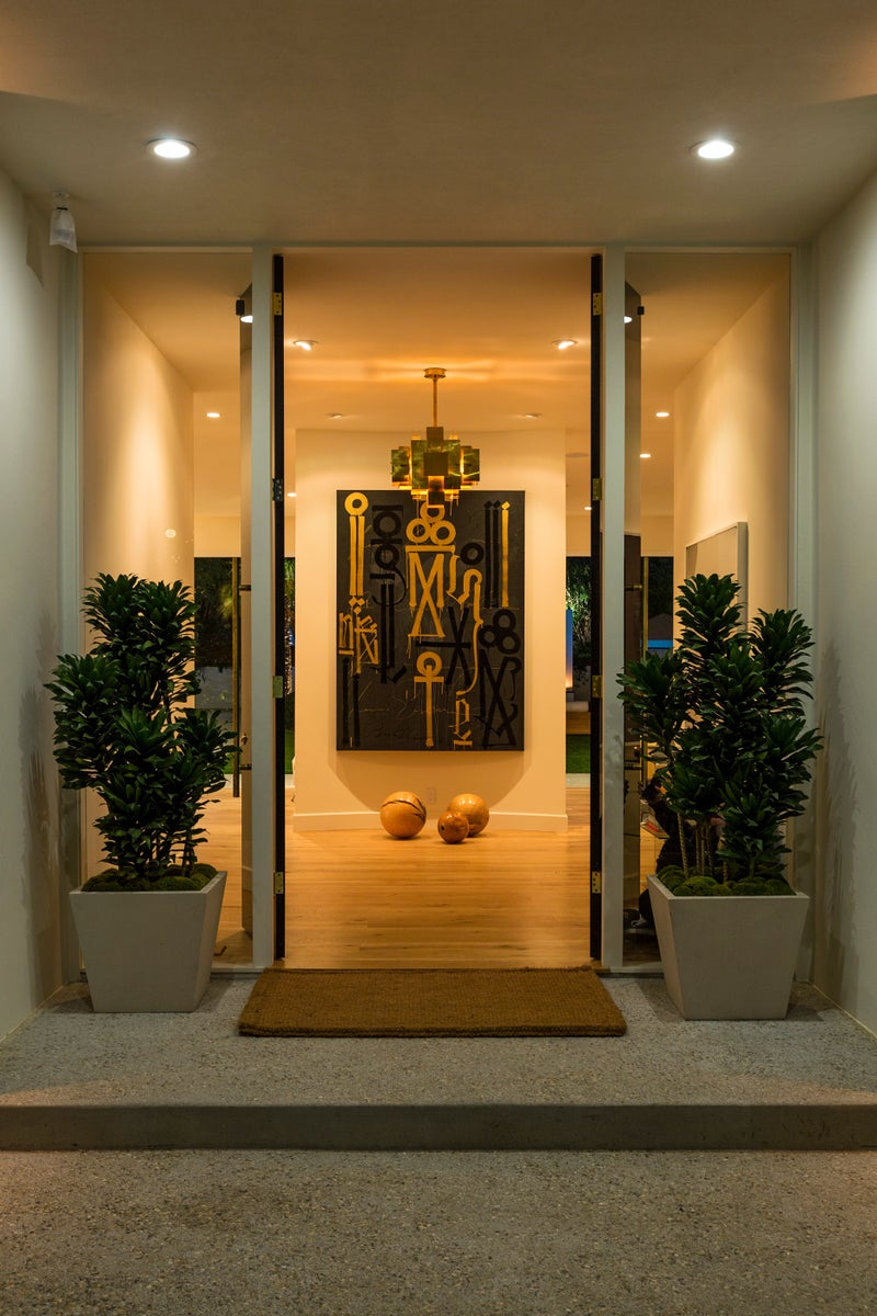 Contemporary Entry and Hall in Beverly Hills, CA by Trip Haenisch & Associates
