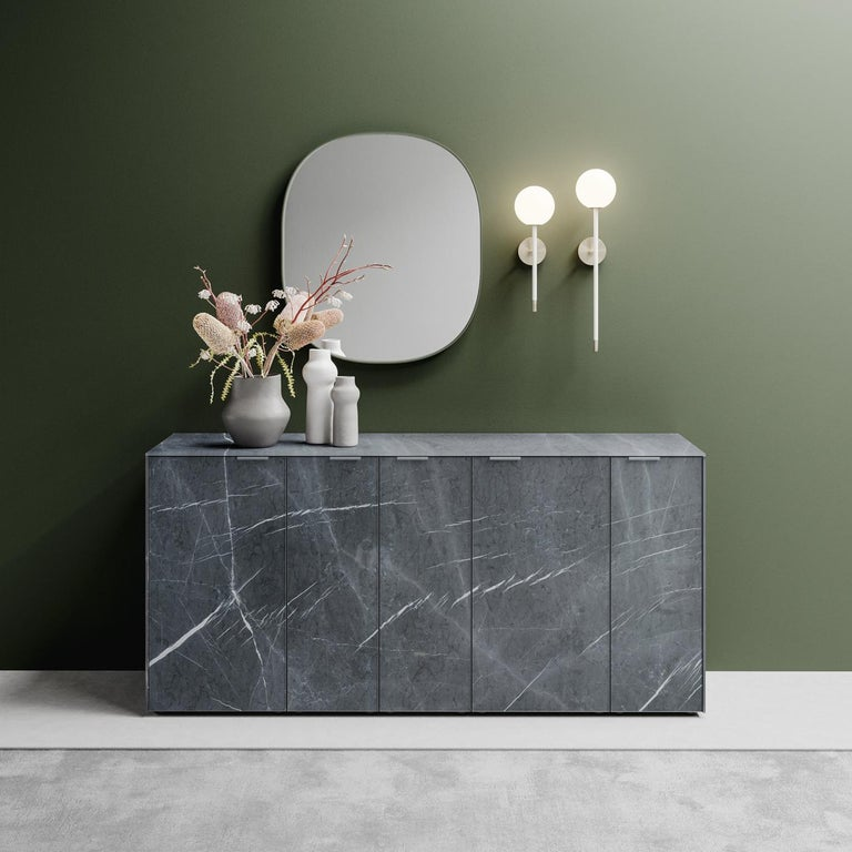 Marked by a charming contemporary elegance, this sideboard boasts an innovative, durable design. It is made of anti-touch glass with a stone gray marble print showcasing the natural veins and captivating allure of the stone. The colors are applied