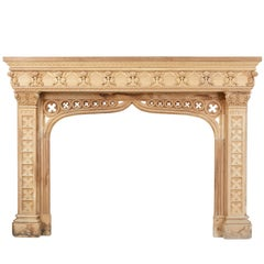 Profusely Carved Walnut and Oak Fire Surround in the Gothic Taste