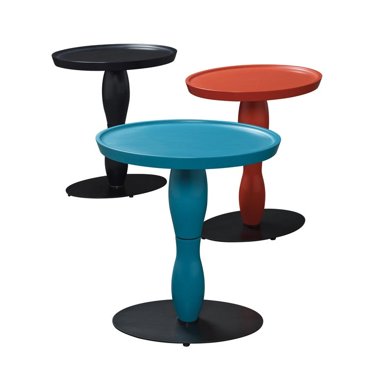 The Mediterranée small table has base in smooth dark bronze, top and leg in semi polished water blue, available with top and leg in semi polished coral red and black.