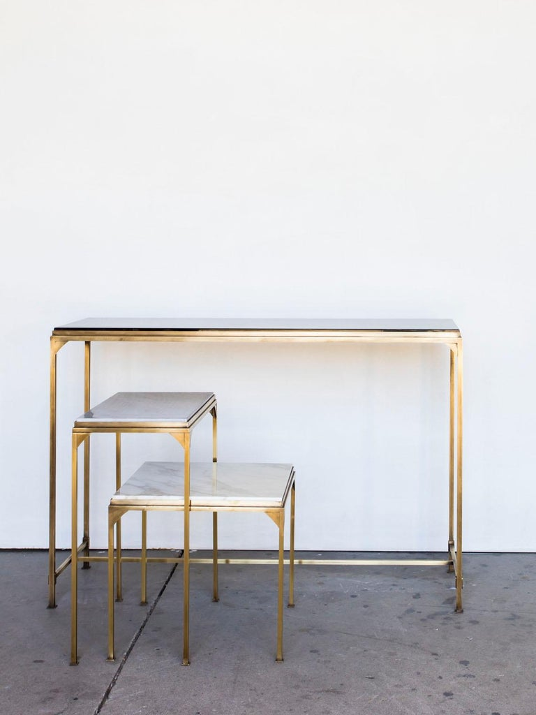 This small side table made out of raw massive brass and beautiful marble in different colours sits perfectly next to a sofa or easy chair, perfect to place your glass of chilled prosecco on!