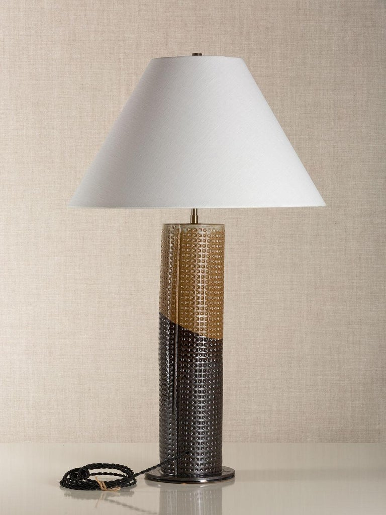 Description: Handmade stoneware slab construction with waffle texture. Lamps are individually crafted and one of a kind.  Finish: Lead over ochre glaze with waffle texture. Antique brass fittings with dimmer switch on socket and braided black cloth