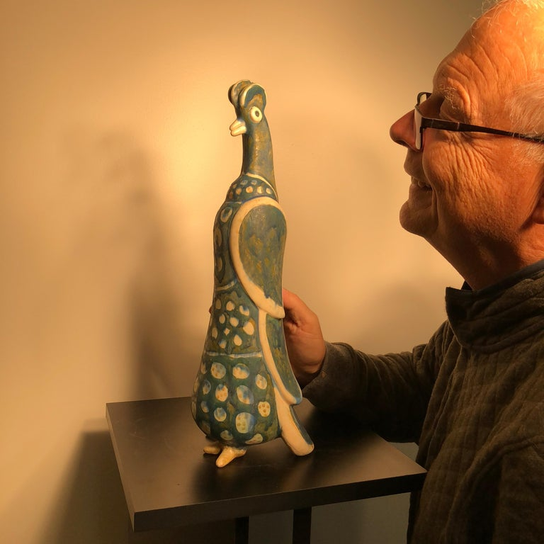 Proud rooster- A master work sculpture designed and hand-painted by Eva Fritz-Lindner (1933-2017)  This is a tall, creative handmade, hand-painted and hand glazed sculpture of a standing rooster. It was designed and hand painted by the now