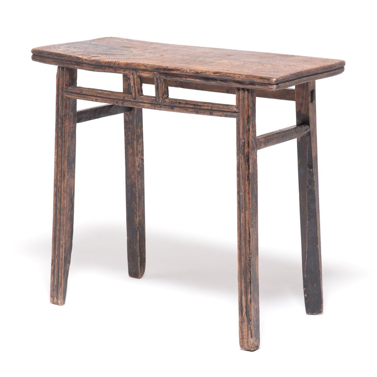 Crafted in China's Shanxi province in the late Qing dynasty, this charming wine table was once a gathering spot for guests to pour wine and make toasts. The table's stretchers and legs were hand rounded to create a barreled form, meant to resemble