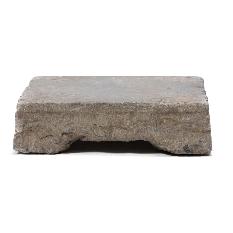 Carved in the late 19th century in northern China, this limestone washing stone would have been used by a Qing-dynasty woman for washing clothes and textiles. Used by beating wet fabrics against its smooth surface with a wooden washing stick,