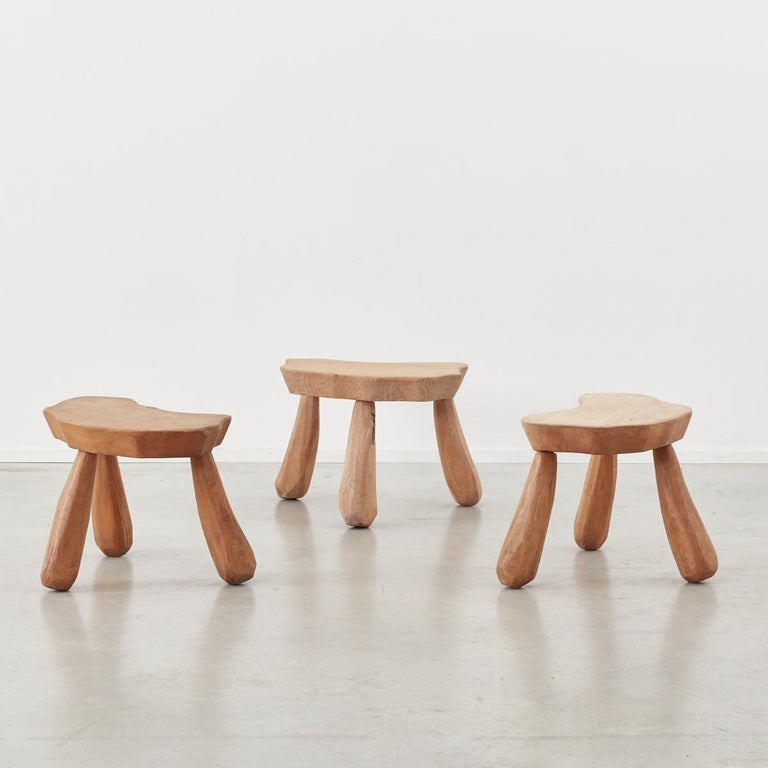 This quirky set of stools crafted from hardwood harks back to a primitive and purist form of carpentry. Each element of the stools is hand whittled so that all but the top surfaces are multifaceted. This effect gives the stools a charming Flintstone