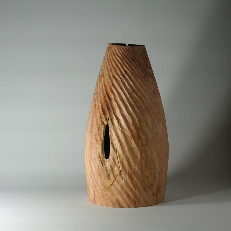 Masterfully handcrafted from a single piece of Prunus Cerasifera, most commonly known as Cherry plum, this extraordinary sculptural vase showcases the natural warm hues of the wood. Part of the Groove collection, it features sinuous and harmonious