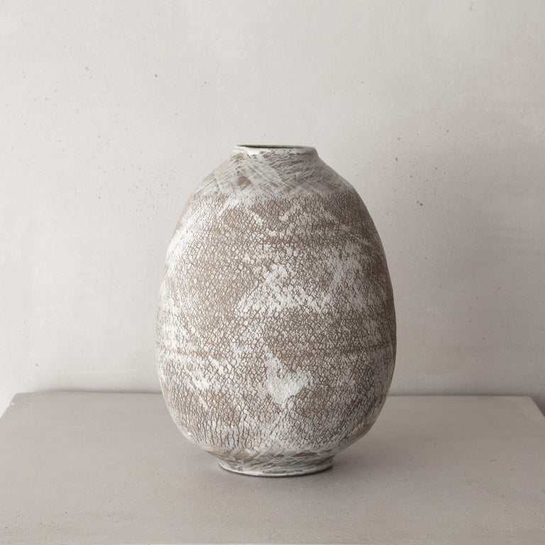 Speliopoulos' passion for craftsmanship, organic textures and forms has informed his work throughout his creative career. This collection features highly textured vessels, reflecting the artist's interest in the malleability and tactile expressions